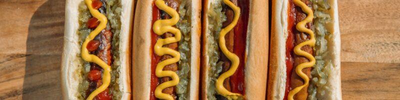 hotdog sandwich on brown wooden table